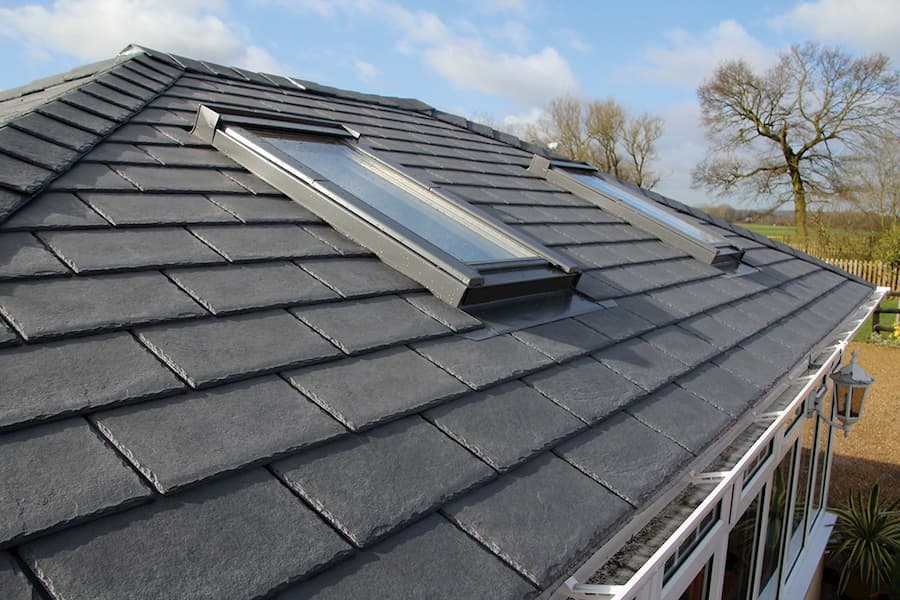 Equinox tiled roofing on large conservatory with velux windows